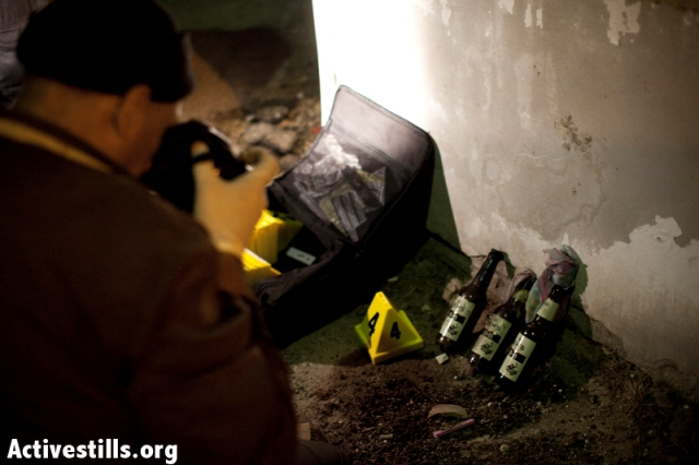 Forensic workers take pictures of unused Molotov cocktails (Oren Ziv / Activestills)