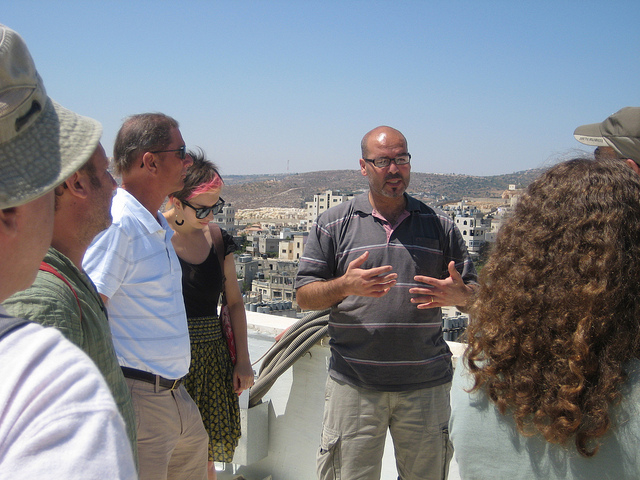 Palestinian guide Husam Jubran giving a tour to Americans in Bethlehem (photo: MEJDI TOURS)
