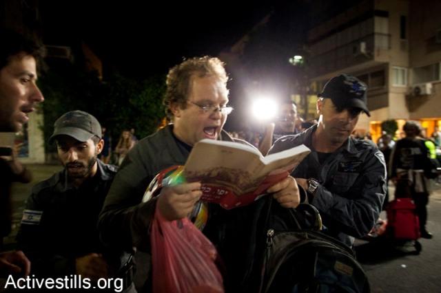 Activist arrested while reading names of Palestinian villages (Activestills)
