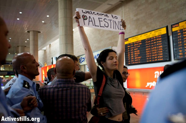 An Israeli activist arrested at Ben Gurion Airport while demonstrating in support of the 'Welcome to Palestine' fly-in protest, April 15, 2012 (Activestills.org)