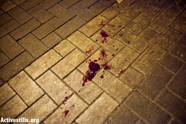 The blood of an African which was attacked during a riot in Hatikva neighborhood on May 23, 2012 (photo: activestills)
