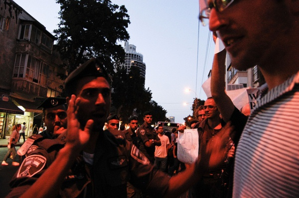 Marching in pain: Images from Tel Aviv's post-riot protest