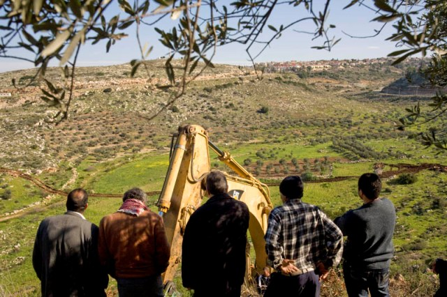 Farmers overlooking construction work in Wadi a-Rasha (Activestills)
