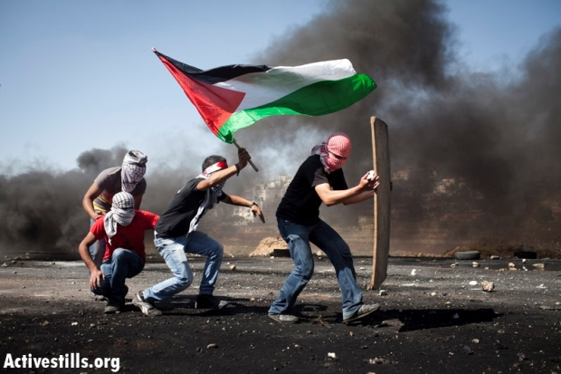 Palestinians confront IDF soldiers during Nakba Day protest near Ofer Military Prison, May 15 2012 (photo: Activestills)