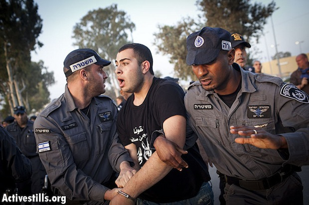 Arrested protesters tasered, beaten, threatened with rape