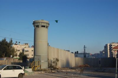 The separation barrier and a guard tower on the edge of Shuafat Refugee Camp (photo: Mya Guarnieri)