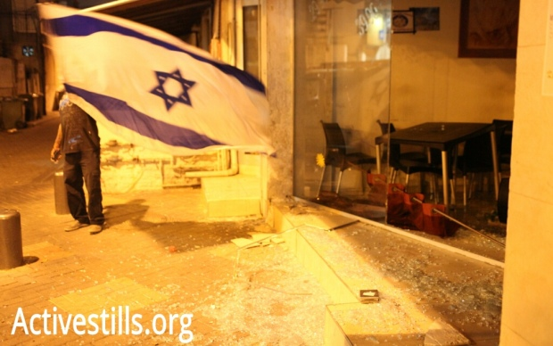 A shop considered a meeting place for African refugees, vandalized following a Tel Aviv rally (photo: Oren Ziv/activestills.org)