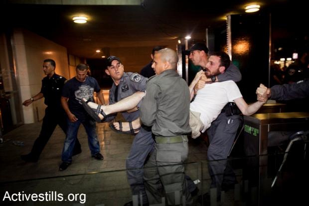 J14 protester arrested, June 23, 2012. At least 89 people were detained or arrested in Tel Aviv (photo: Activestills.org)