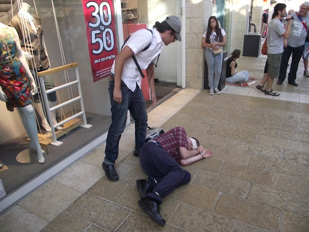 Activists stage street action to protest Israeli torture practices
