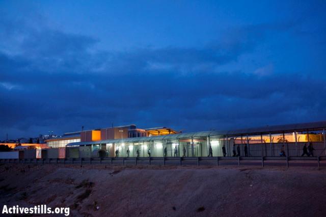 Eyal checkpoint. In the background: Qalqilya (Oren Ziv / Activestills)