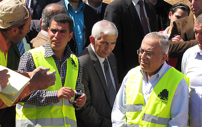 Nasser Nawaj'ah (L) and Salam Fayyad (Courtesy of B'Tselem)