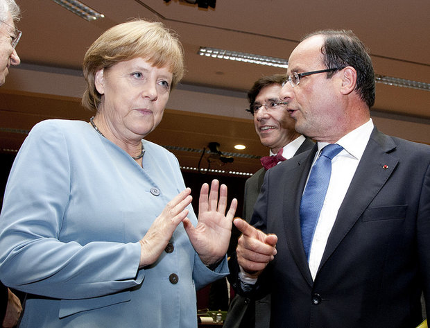 German Chancellor Angela Merkel speaks with newly-elected French President Francois Hollande, Brussels, May 23, 2012 (photo: flickr/cc European Council)