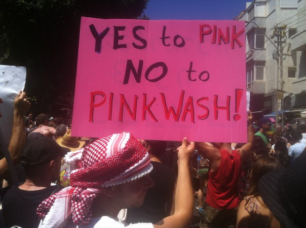 """Participants in Tel Aviv's Gay Pride parade protesting """"pinkwashing"""" by Israeli government, June 8, 2012 (photo: Roee Ruttenberg)"""