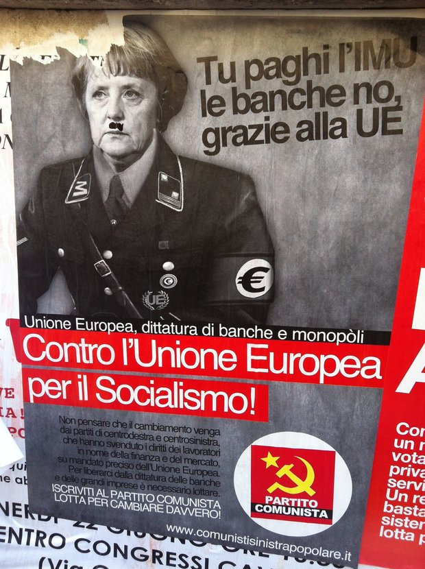 A mustache is added to the image of Merkel, further likening her to Hitler, Rome, Italy, June 24, 2012 (photo: Roee Ruttenberg)
