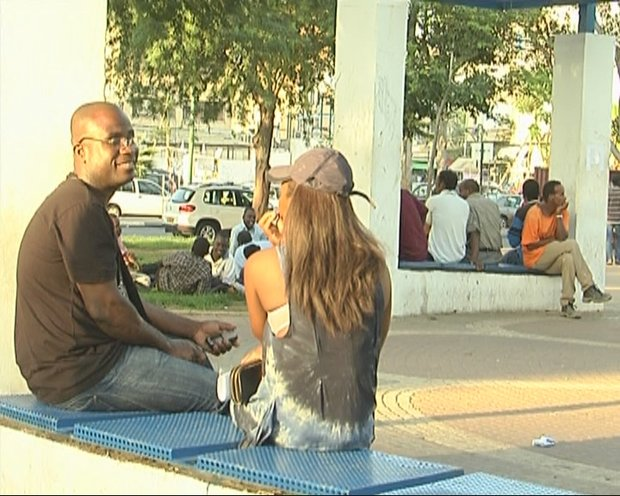 Bernand Abet, a national of Cote d'Ivoire, sits in Lewinsky Park with a friend and fellow Ivorian, Tel Aviv, 17 June 2012 (photo: Roee Ruttenberg)