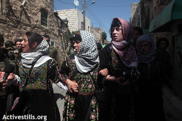 Women challenge segregation of Hebron street in direct action
