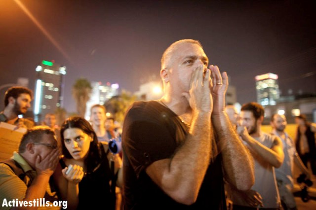 """The state broke its side of the social contract"". Tamar demonstrating (Oren Ziv / Activestills)"
