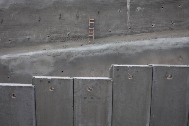 """A wall can alway be climbed over."" The wall in al-Walajah, near Jerusalem. (Oren Ziv / Activestills)"
