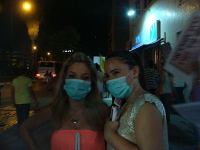 Protesters wear surgical masks to symbolize their belief that Africans carry contagious diseases (photo: Mya Guarnieri)