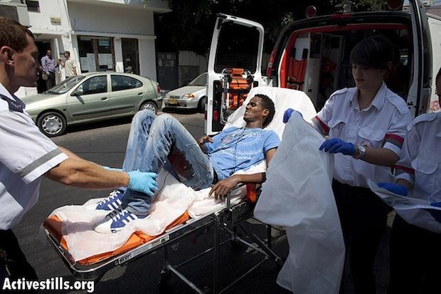 Wounded Eritrean man after knife attack in South Tel Aviv Internet cafe July 31, 2012 (OrenZiv/Activestills)