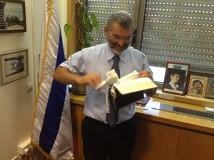 MK Michael Ben-Ari tearing pages from the New Testament (photo: Itamar Ben-Gvir)