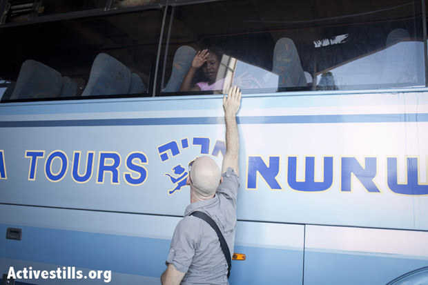 Rami Gudovitch, an Israeli activist, says goodbye to a child who was under his care in recent years. Tel-Aviv, Israel, August 8, 2012. (Photo: Shiraz Grinbaum/Activestills.org)