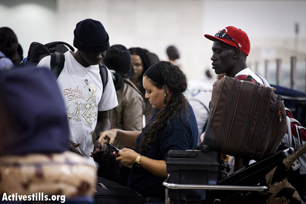 South Sudanese refugees receive travel documents at Ben-Gurion Airport, Israel, June 17, 2012. (Photo: Oren Ziv/Activestills.org)