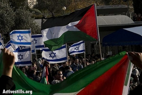 Palestinian and Israeil flags (Activestills)