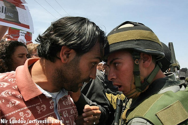 Confrontation between Palestinian and IDF soldier in Gush Etzion, 2007 (Activestills)