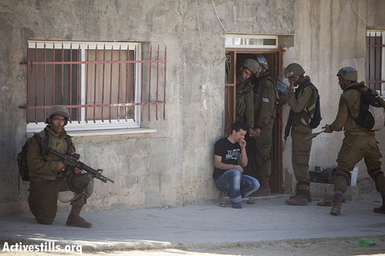 Israeli soldiers raiding Nabi Saleh village, conducting a house by house search and arresting young men and activists, August 24, 2012, shortly after the violent dispersal of the weekly protest against the occupation held in the village.