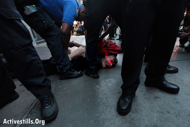 An Occupy Wall Street protester is arrested by police after a march from Washington Square Park to the Financial District, in New York City, September 15, 2012. Occupy Wall Street marked its first anniversary on Monday. (photo: Tess Scheflan/ Activestills.org)