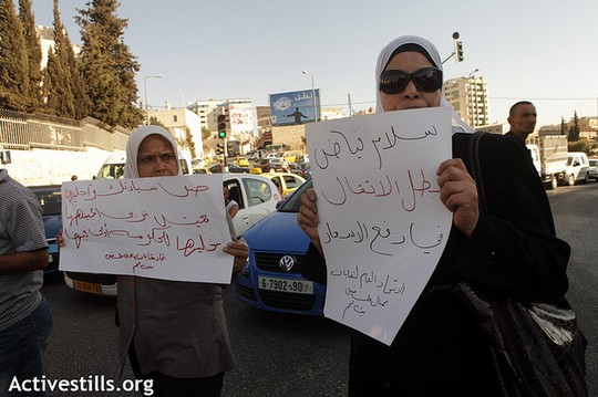 """A sign reads: """"Salam Fayyad, the hero of raising prices!"""" as Palestinians block traffic in the main street of Bethlehem, September 6, 2012. (photo: Anne Paq/Activestills.org)"""