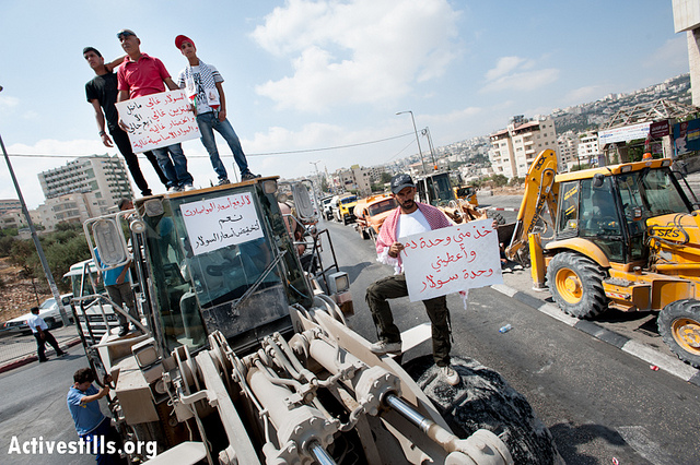 Palestinian heavy equipment drivers block traffic at Bethlehem's Bab Iskak intersection to protest the high cost of fuel and food, September 10, 2012. (photo by: Ryan Rodrick Beiler/Activestills.org)