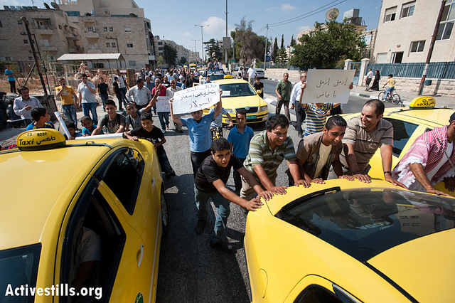 PHOTO: Palestinian taxi and truck drivers protest high fuel and food prices