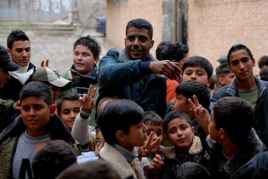 Zakaria Zubeidi (center) outside the Freedom Theater in Jenin (photo: Jenny Nyman)