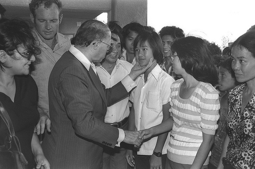 Prime Minister Begin greeting Vietnamese refugees in Israel in 1977 (photo: Government Press Office)