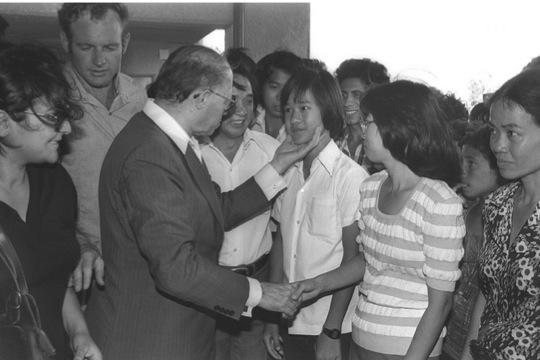 Menachem Begin greeting Vietnamese refugees given Israeli citizenship (photo: GPO)