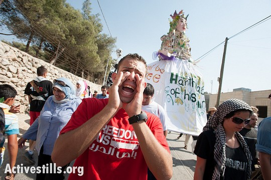 Carrying giant puppets, Palestinians of Al Walaja, together with Palestinian, international, and Israeli supporters march through the West Bank village of Al-Walaja as part of the Freedom Bus campaign. (photo: Ryan Rodrick Beiler/Activestills.org)