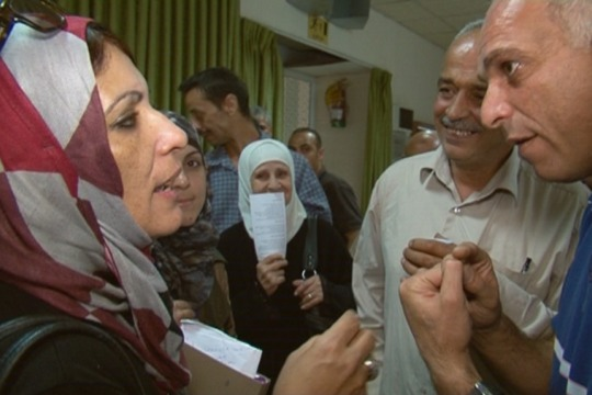 """Maysoun Qawasmi from """"Women's List"""" showing she can hold her own at a debate in Hebron, Oct 18, 2012 (photo: DC)"""