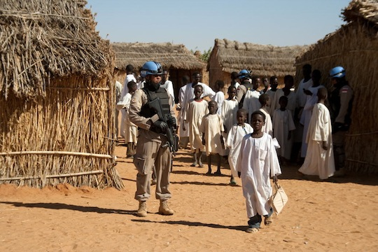 A UNAMID police officer patrols the Zamzam IDP camp in Darfur (United Nations Photo)