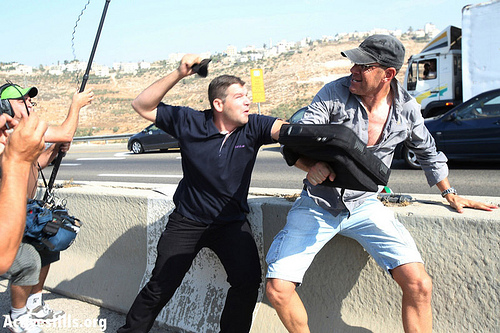Photos: Palestinians block Route 443 to protest settler violence