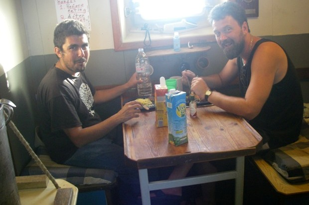 Pro-Palestinian activists share a meal aboard the Estelle.