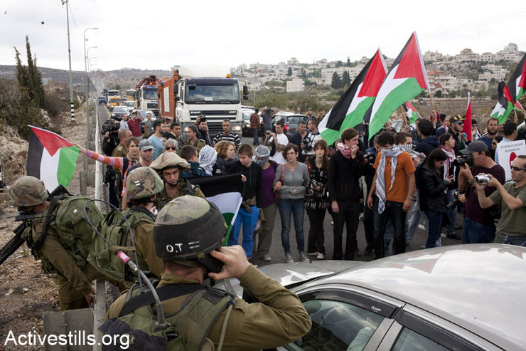 Photos: Palestinians protest occupation, block roads throughout West Bank