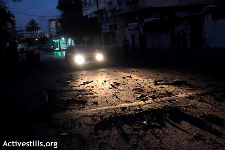 Debris on the road following the first strike on Gaza, which killed the head of Hamas' military wing, Ahmed Jabari, Gaza City, November 14, 2012. (photo by: Anne Paq/Activestills.org)