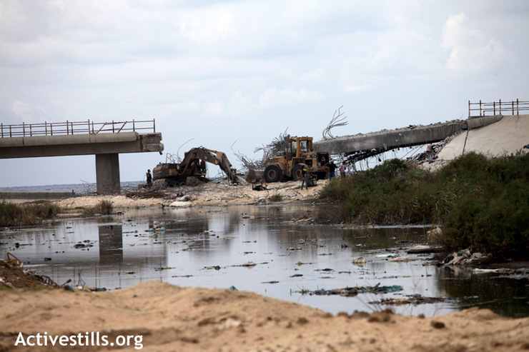 View of a bridge which was demolished by an Israeli air strike. The bridge used to connect Gaza City and Rafah, Gaza Strip November 24, 2012. (Photo by: Anne Paq/Activestills.org)