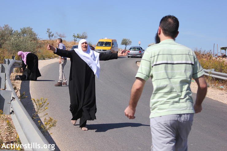 The mother of Hassan Safadi runs to greet her son as he arrives at the Jubara checkpoint near the West Bank city of Tulkarm after his release from Israeli military prison, October 29,2012. Hassan reportedly went on an on-and-off hunger strike for 168 days in Israeli military prison, in protest of Israel's 'administrative detention' policy, under which Palestinians can be detained for prolonged periods of months or years without any charges brought against them. (photo by: Ahmad Al-Bazz/Activestills.org)