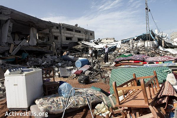 Ruins of three buildings consisting of a factory for building equipments and 2 homes, belonging to Al Adad family, in the al-Shujaiya neighborhood, Gaza city, November 18, 2012. The family escaped  after the Israeli army fired three warning rockets which were followed 5 minutes after by an F16 which destroyed the buildings.