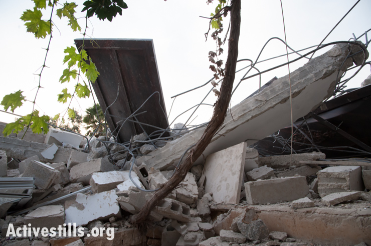 Photos: Palestinian house demolished for sixth time