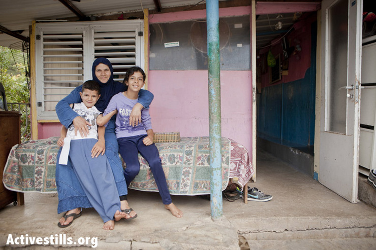 The Khawalid Bedouin family posing outside their home, currently under threat of demolition, October 27, 2012. The four Khawalid family homes are built on the same property, and are all slated for demolition. The Israeli administration has issued the demolition order, announcing that the lands are bordering an area planed to be a national park. (photo by: SG/Activestills.org)
