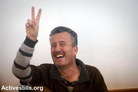 Bassem Tamimi, coordinator of the Nabi Salih popular committee, is seen inside a court room in the Israeli military offer camp, just before his hearing on December 4, 2011.Photo by: Oren Ziv/ Activestills.org